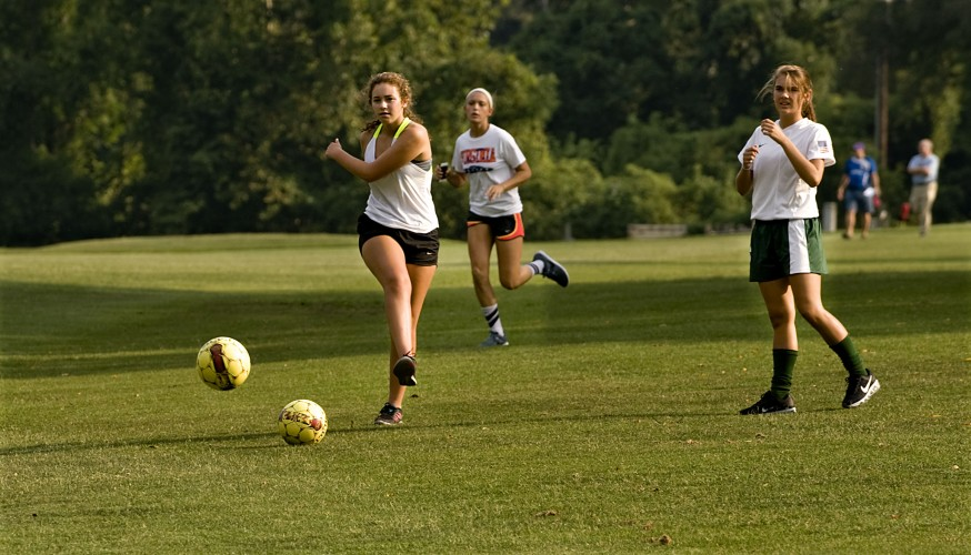 Kali Slate,15, left,  Kaley Foulks, 14, center, and  Cacey  Stives, 14, right, all of Front Royal,  play a round of FootGolf at Front Royal Golf Club in Front Royal. Rich Cooley/Daily